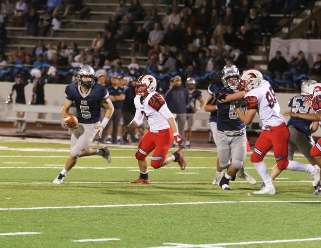 Great Falls High quarterback Blake Thelen scrambles away from the Bozeman pass rush Thursday night at Memorial Stadium.