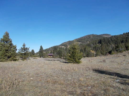 A home peaks out from the trees across Falls Creek from the Barrett property on the Rocky Mountain Front. Concerns about subdivision on the Barrett land, after it came up for sale, prompted the Rocky Mountain Elk Foundation and Dan Barrett to begin discussions about preserving it.