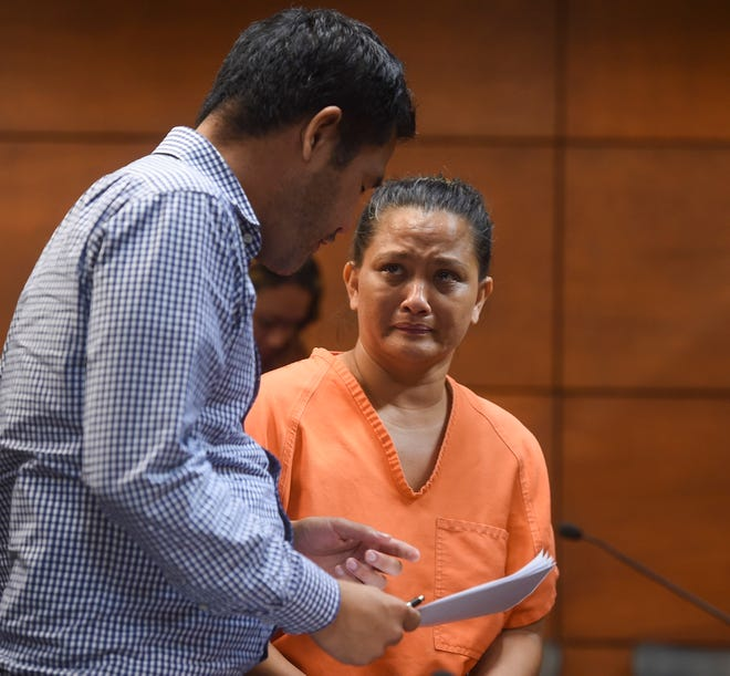Public School teacher Andrea Maanao Cruz, 44, right, speaks with attorney Karlo Dizon after her magistrate's hearing at the Superior Court of Guam in Hagåtña, Oct. 19, 2018. Cruz is charged and accused for issuing fraudulent diplomas and transcripts from a sham tutoring company in exchange for money, according to court documents.