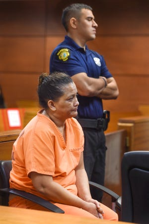 Andrea Maanao Cruz, seated, attends her magistrate's hearing at the Superior Court of Guam on Friday, Oct. 19, 2018. Cruz, a public school teacher, is accused of issuing fraudulent diplomas and transcripts from a sham tutoring company in exchange for money.