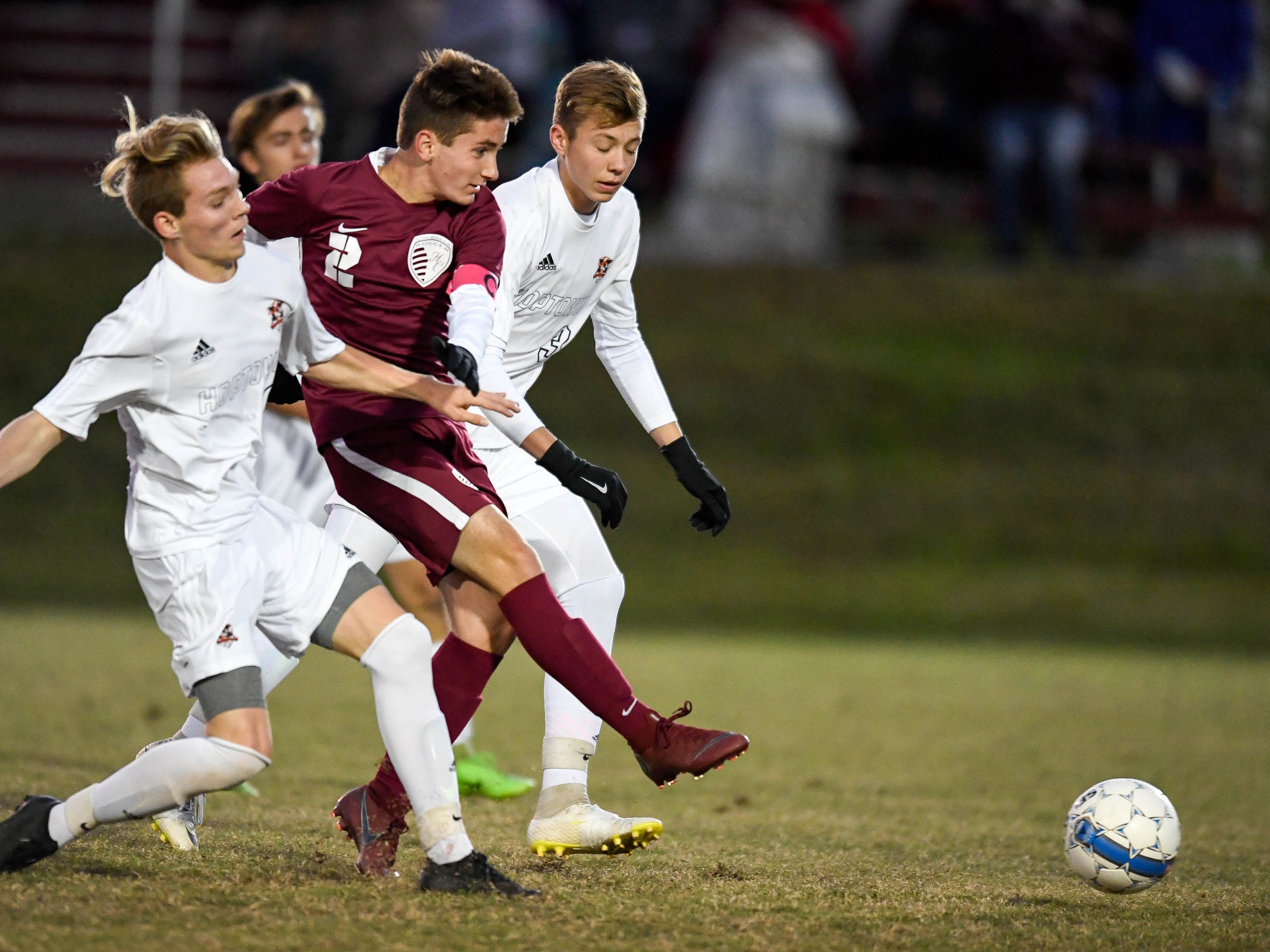 Henderson County's Samuel Cloutier (2) attacks through two Hopkinsville defenders as the Henderson County Colonels play the Hopkinsville Tigers in the regional final at Madisonville-North Hopkins High School Thursday, October 18, 2018.