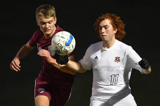 Henderson County's Lucas Butler (16) and Hopkinsville's Welby Horn (11) try to control the ball near the Tiger goal as the Henderson County Colonels play the Hopkinsville Tigers in the regional final at Madisonville-North Hopkins High School Thursday, October 18, 2018.