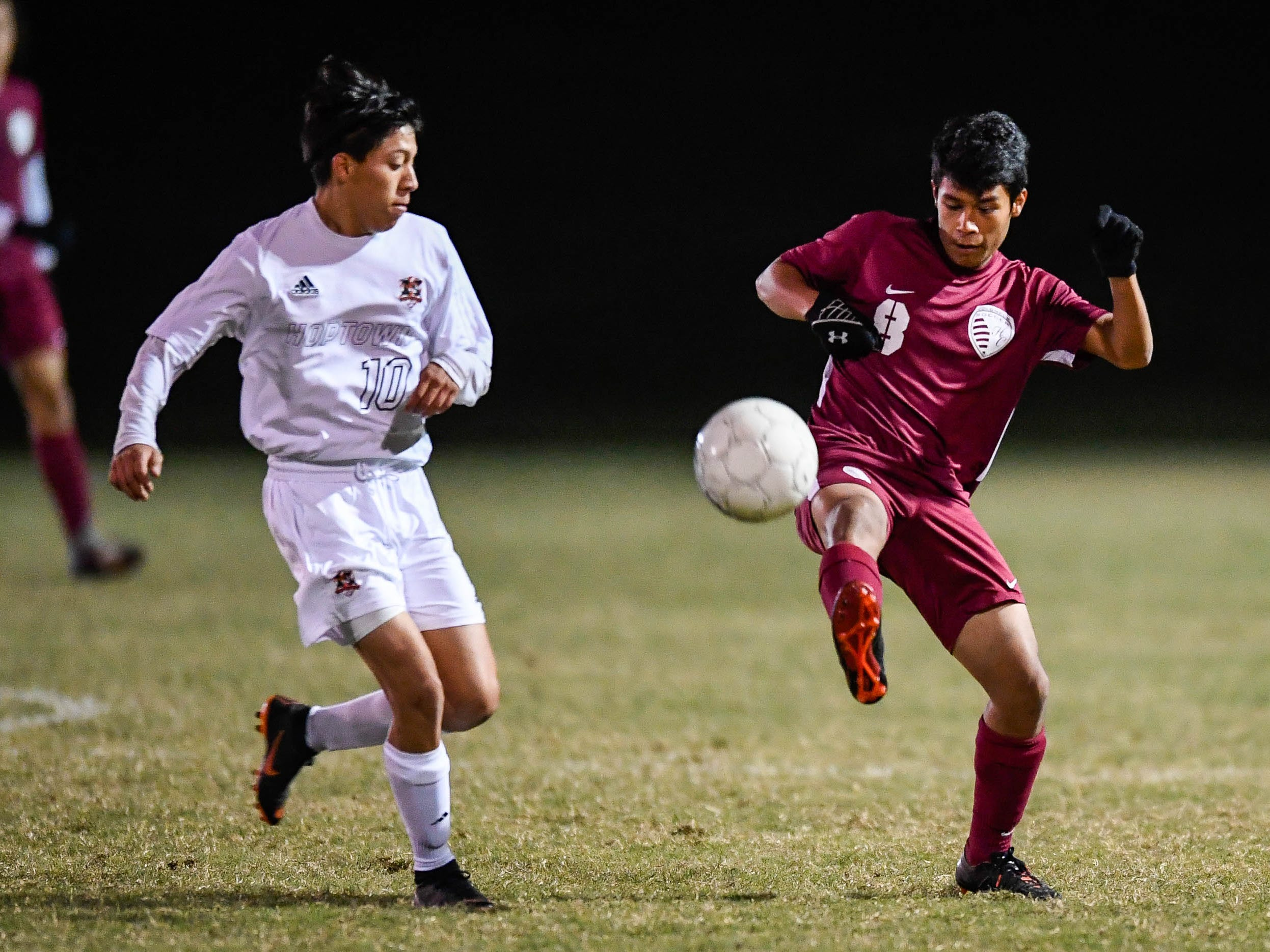 Hopkinsville's Edwar Acosta (10) and Henderson County's Cooper Wilson (9) as the Henderson County Colonels play the Hopkinsville Tigers in the regional final at Madisonville-North Hopkins High School Thursday, October 18, 2018.