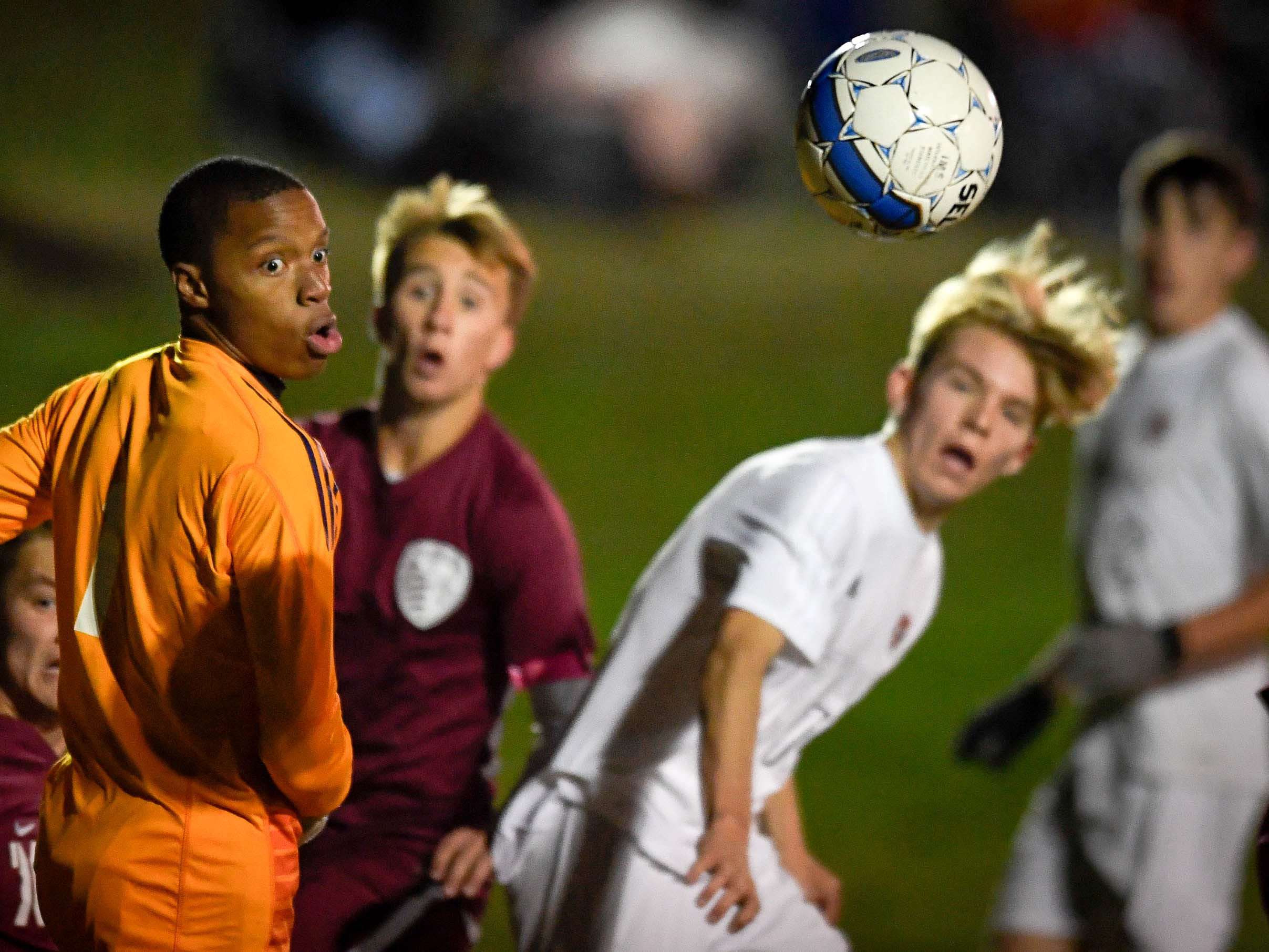 Battle in front of the Hopkinsville goal as the Henderson County Colonels play the Hopkinsville Tigers in the regional final at Madisonville-North Hopkins High School Thursday, October 18, 2018.