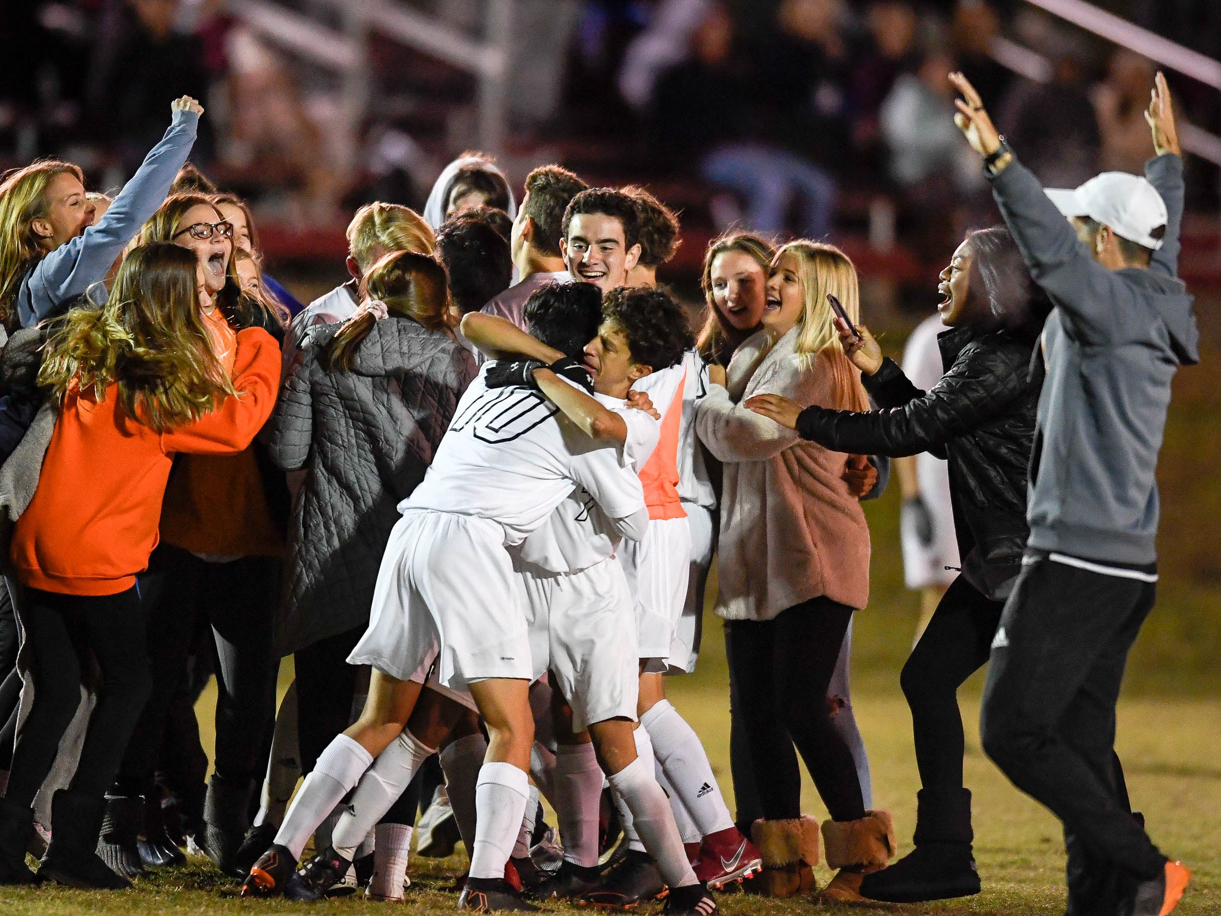 Hopkinsville team and fans celebrate winning the Second Region Championship 2-0 as the Henderson County Colonels play the Hopkinsville Tigers in the regional final at Madisonville-North Hopkins High School Thursday, October 18, 2018.