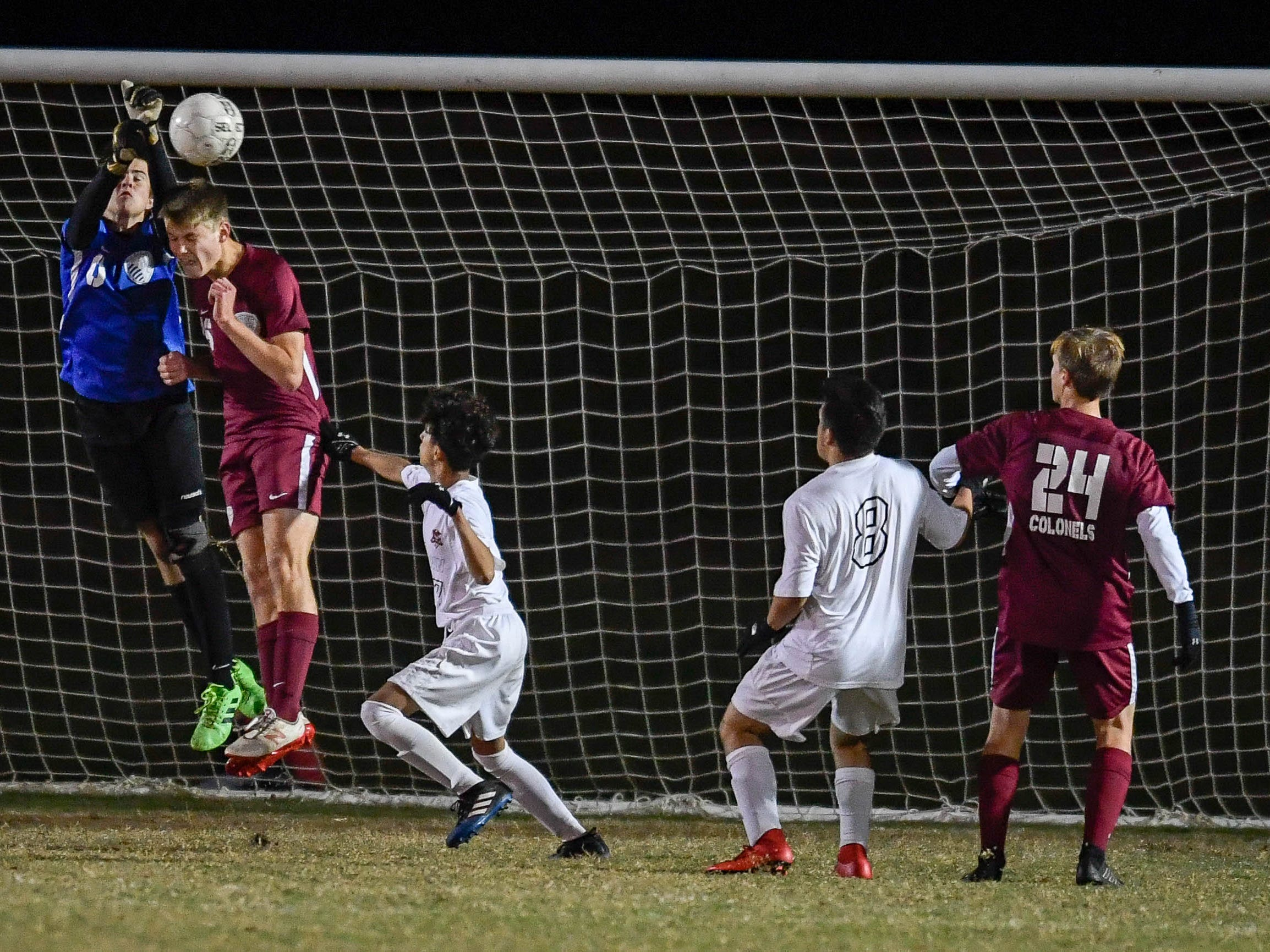 Henderson County goalie Adam Beickman (0) and teammate Lucas Butler (16) block a goal shot as the Henderson County Colonels play the Hopkinsville Tigers in the regional final at Madisonville-North Hopkins High School Thursday, October 18, 2018.