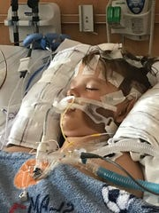 Tyler Aul in the ICU at Riley Hospital for Children at IU Health after his life was saved during a surgery to remove a brain tumor.