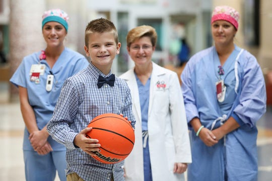 Tyler Aul reunited Friday with some of the people who saved his life in May 2017 at Riley Hospital for Children in Indianapolis. From left behind him, nurse Tylyn Bremer, neurosurgeon Jodi Smith and nurse Eileen Bergin are part of the team that saved his life when he began to bleed uncontrollably during surgery.