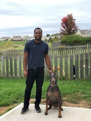 Darius Smith, pictured here with his dog King, will open Indy's Indoor Bark Park in December.