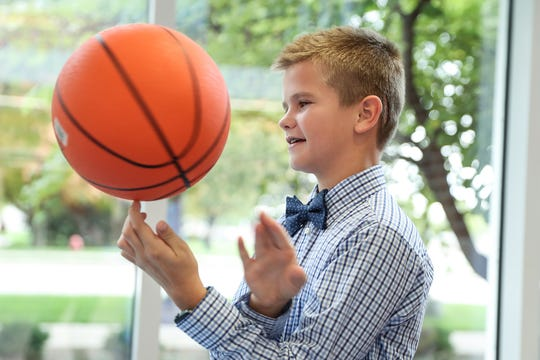 Tyler Aul, 12, is back to his passion of playing basketball after a near-death experience in 2017, pictured playing ball at Riley Hospital for Children in Indianapolis, Friday, Oct. 19, 2018. While neurosurgeon Jodi Smith was operating on Aul to remove a benign brain tumor, two arteries began to bleed uncontrollably. Smith persisted for seven hours until the bleeding stopped, during which Aul lost more blood than 100 of her typical patients combined. Aul is a Yorktown seventh grader and dreams of playing in the NBA.