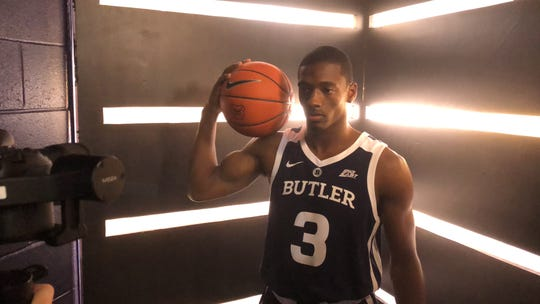 Kamar Baldwin poses in Butler's new dark blue uniforms.