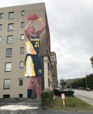 """The Reggie Miller mural on the side of  """"the Mich"""" at 127 E. Michigan St. is complete."""