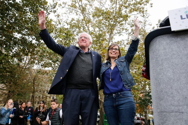 U.S. Sen Bernie Sanders, left, I-Vt., campaigns for Liz Watson, right, who is running for Congress as a Democrat, during a rally in Dunn Meadow at Indiana University, Friday, Oct. 19, 2018 in Bloomington, Ind.