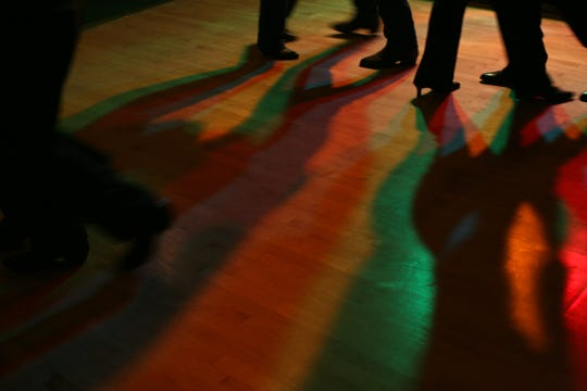Guests take to the dance floor during folk dancing night at the Moose Lodge on Nov. 19, 2006, in Iowa City.