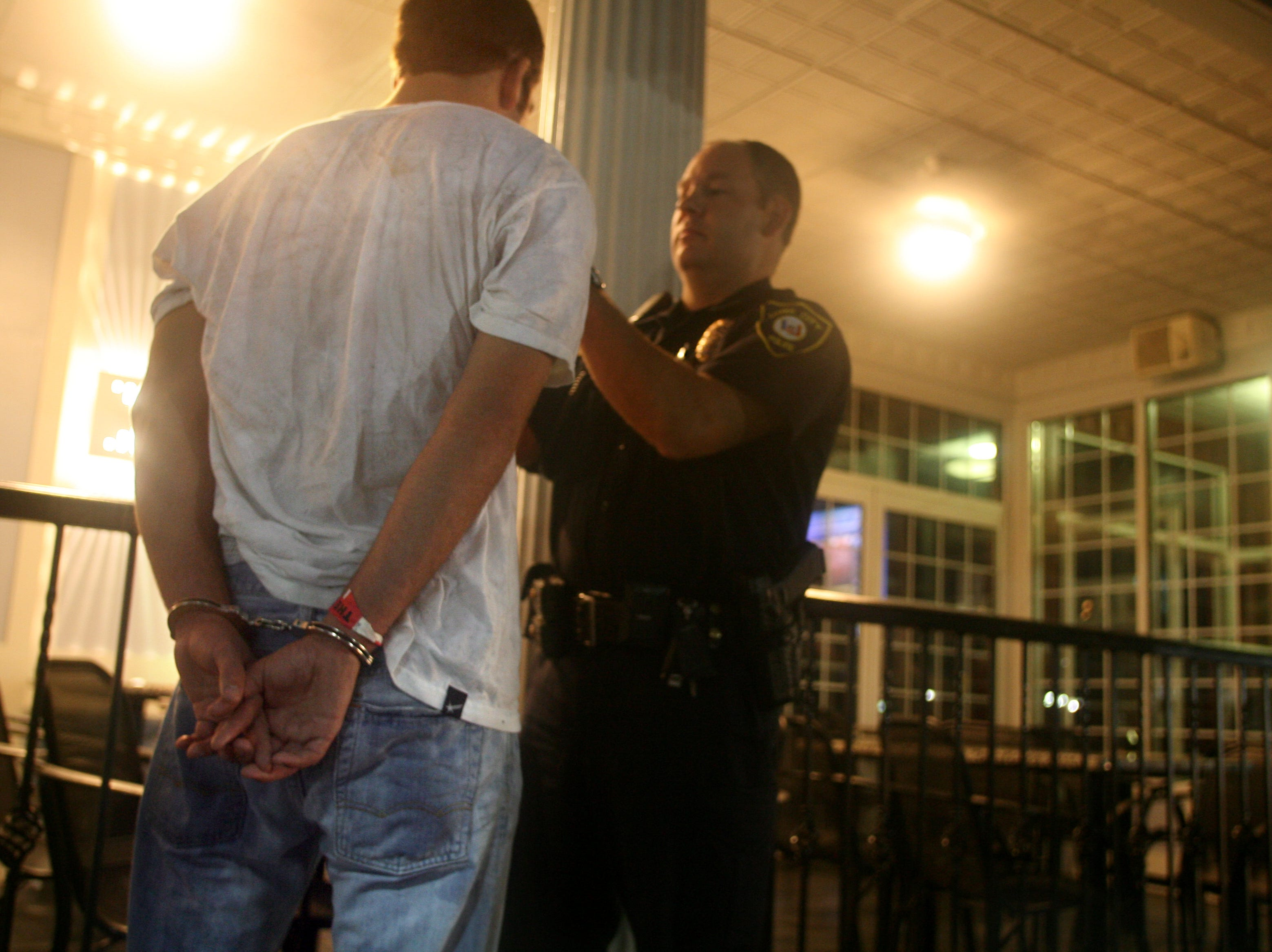 "Iowa City Police Officer Darin Zacharias issues a breathalizer test to an 18-year-old outside ""The Summit,"" Thursday August 23, 2007, in downtown Iowa City, Iowa."
