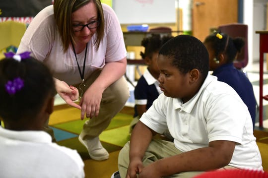 Linwood Elementary teacher April Ketchum speaks to kindergartner student Antroine Anderson. Vaughan, Miss. Monday, April 23, 2018.