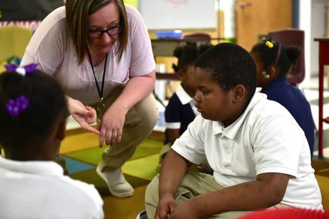Linwood Elementary teacher April Ketchum speaks to kindergartner student Antroine Brown. Vaughan, Miss. Monday, April 23, 2018.