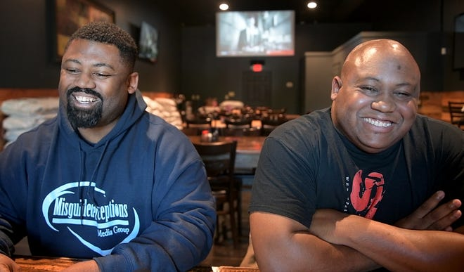 """Jaron Lockridge and Larry Triplett, Jr. smile during an interview about a new web series titled """"The Stix."""" Lockridge wrote, directed, and produced the series while Triplett stars as one of the main cast members."""
