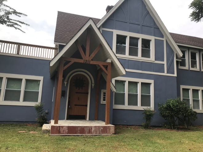 FrenCherry Miller added the front porch and painted this house on Highland Avenue in Jackson.