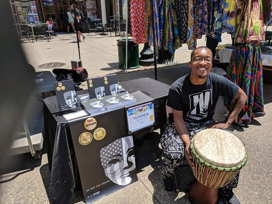 Corey Hodge is also a gifted drummer in the West African tradition. Here he attends the Kuumba Festival. June 22, 2018.
