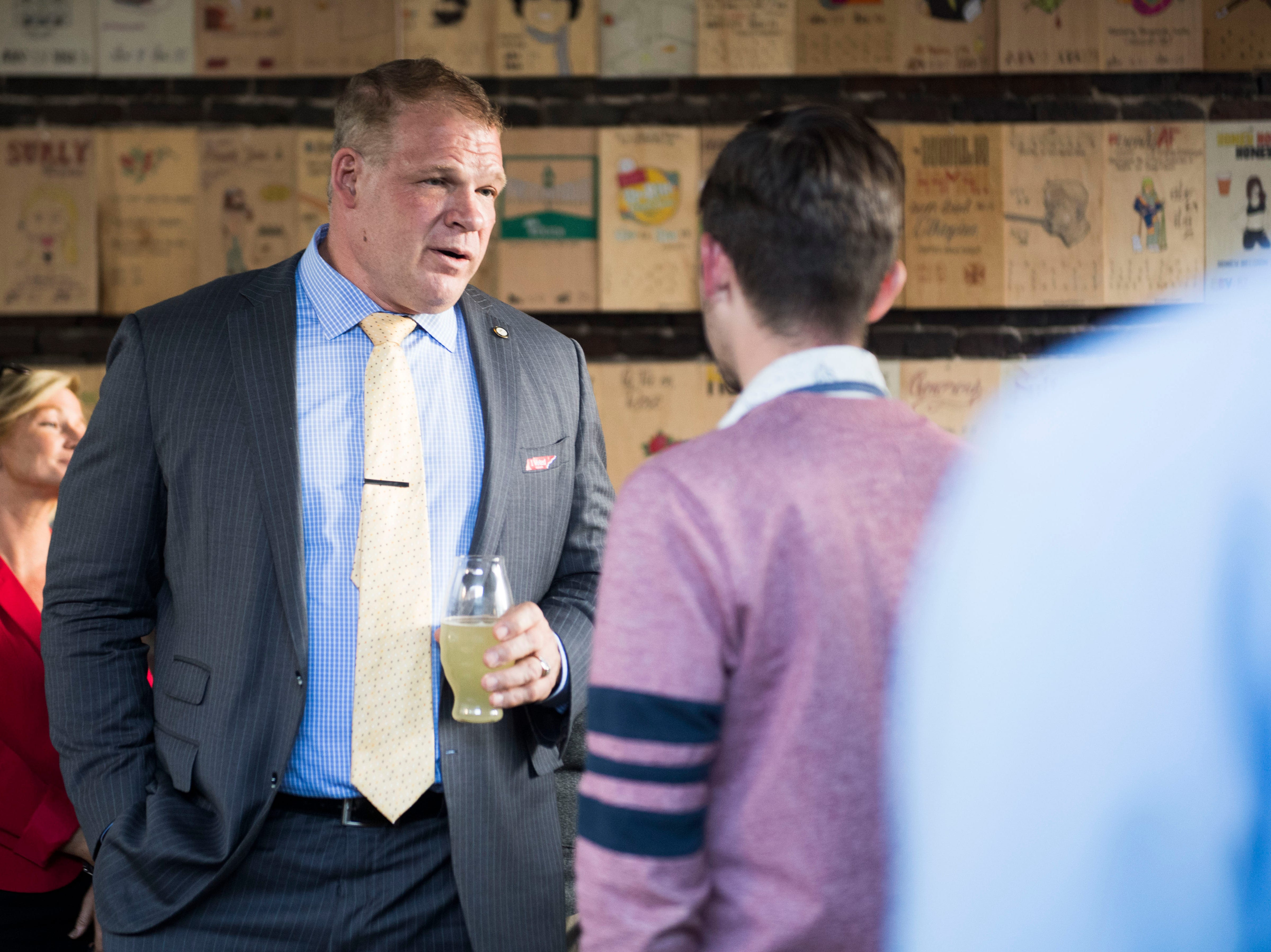 Knox County Mayor Glenn Jacobs speaks with an attendee at the News Sentinel's second News & Brews event at Pretentious Beer Co. on Oct. 18, 2018.