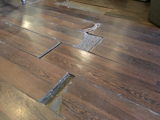 Warped and damaged flooring inside Jackie's Dream restaurant is one of many reasons owner Jackie B. Griffin has decided to move from the McCalla Avenue location.
