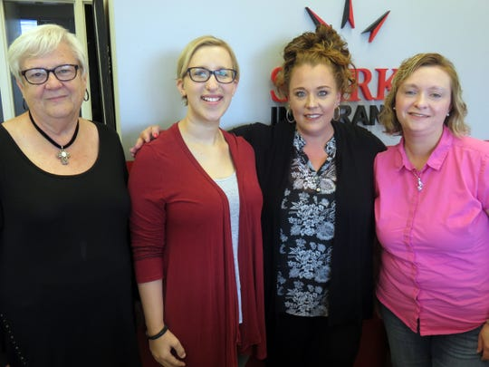 Among the Sparks Insurance office staff enjoying their new Sherrill Boulevard facility on Oct. 17, 2018, are, from left, Faye Bean, Savannah Price, Amber Blair and Natalie Howard.