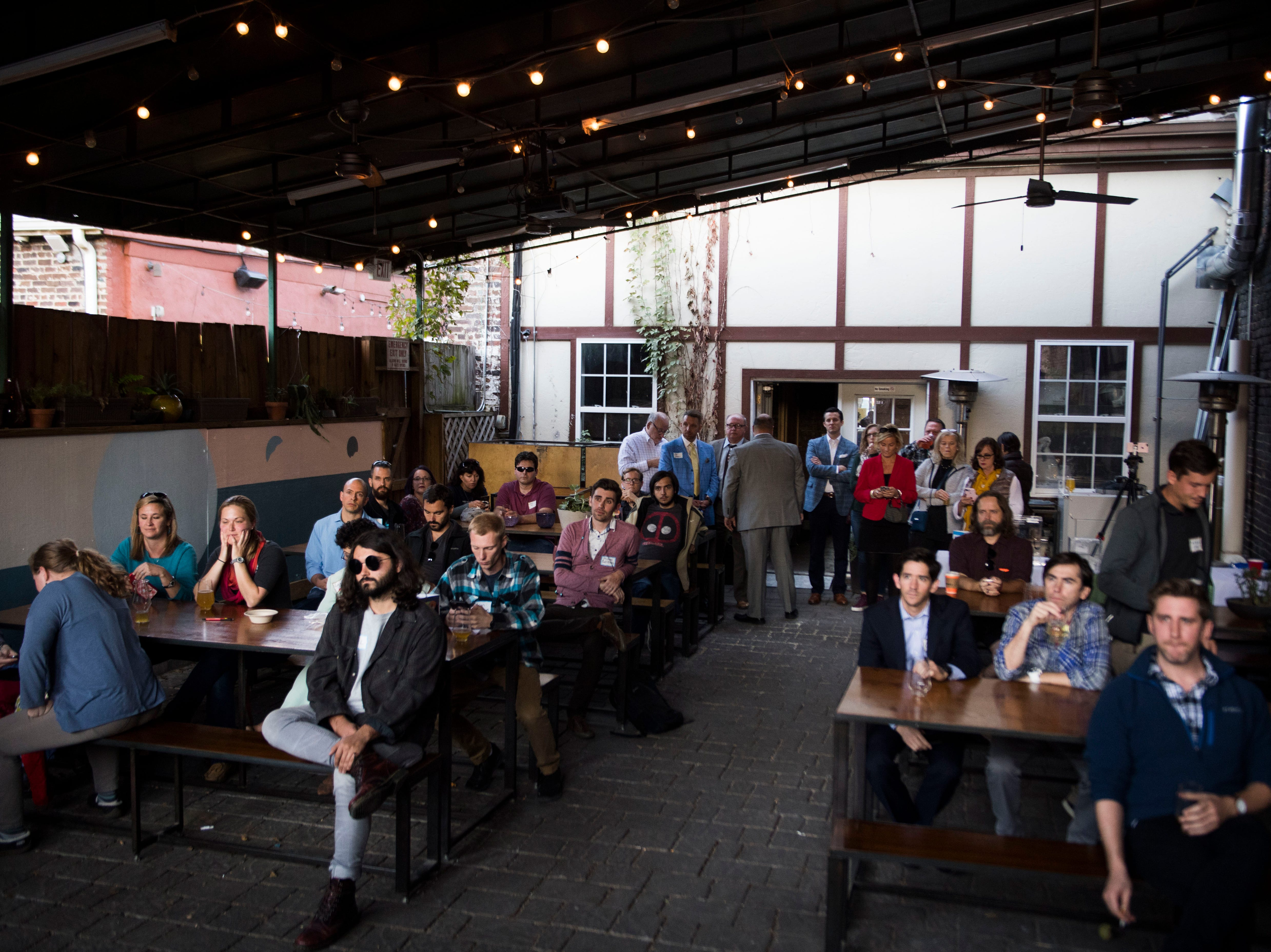 Attendees listen at the News Sentinel's second News & Brews event at Pretentious Beer Co. Thursday, Oct. 18, 2018. Knox County Mayor Glenn Jacobs participated in a Q&A session lead by reporter Tyler Whetstone.