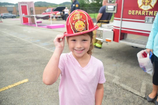 Izzy Henley, 6, is all smiles in her fire hat given to her by the Karns Fire Department during a fire safety demonstration held at Karns Elementary School Tuesday, Oct. 16.