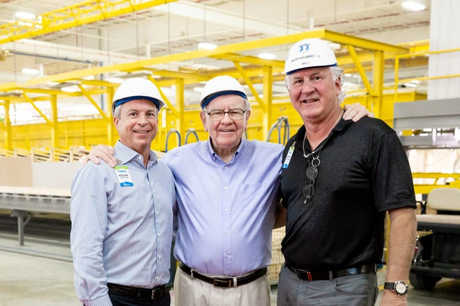 From left, Clayton President and CEO Kevin Clayton, Berkshire Hathaway Chairman and CEO Warren Buffett and Clayton Home Building Group President Keith Holdbrooks pose for a photo during Buffett's visit to Clayton Homes' Appalachia facility Oct. 5.