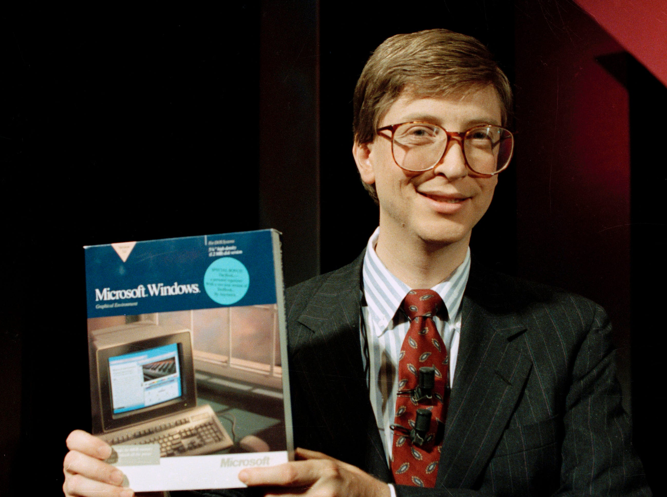 In this May 22, 1990 file photo, Microsoft Chairman Bill Gates introduces the company's Windows software in New York.  Microsoft's iconic frontman is finally giving up his full-time gig at the company to devote more time to world health charity work.