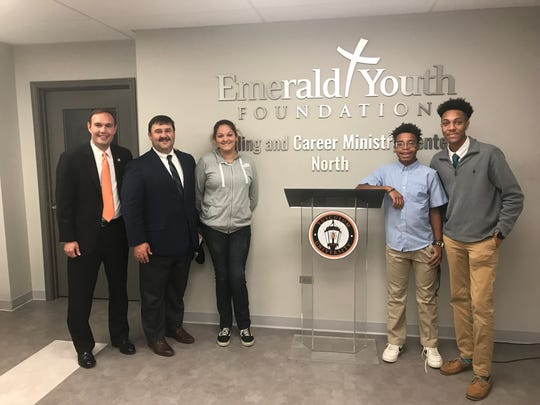 Tusculum University President James Hurley, Emerald Youth Foundation President and CEO Steve Diggs, ministry students Nicole Geller and Javell Swanson, and Tusculum University student Kenderick Grant joined together to announce the new partnership.