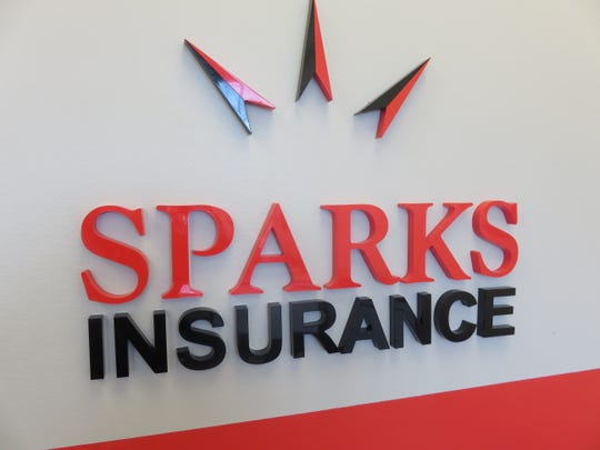 Sparks Insurance logo inside front door of new office.