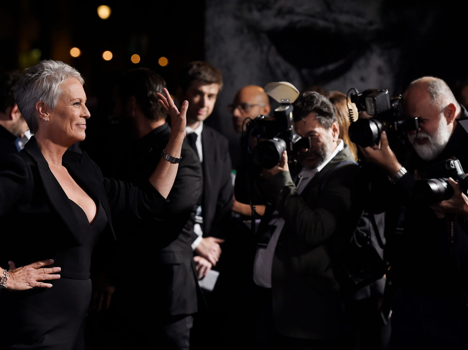 "Jamie Lee Curtis, star of ""Halloween,"" waves to photographers at the premiere of the film at the TCL Chinese Theatre, Wednesday, Oct. 17, 2018, in Los Angeles. (Photo by Chris Pizzello/Invision/AP)"