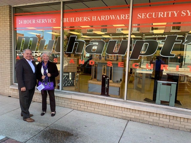 Pat Carr took her Purple Purse to see Mike Gibson, co-owner of Mulhaupt's Security.