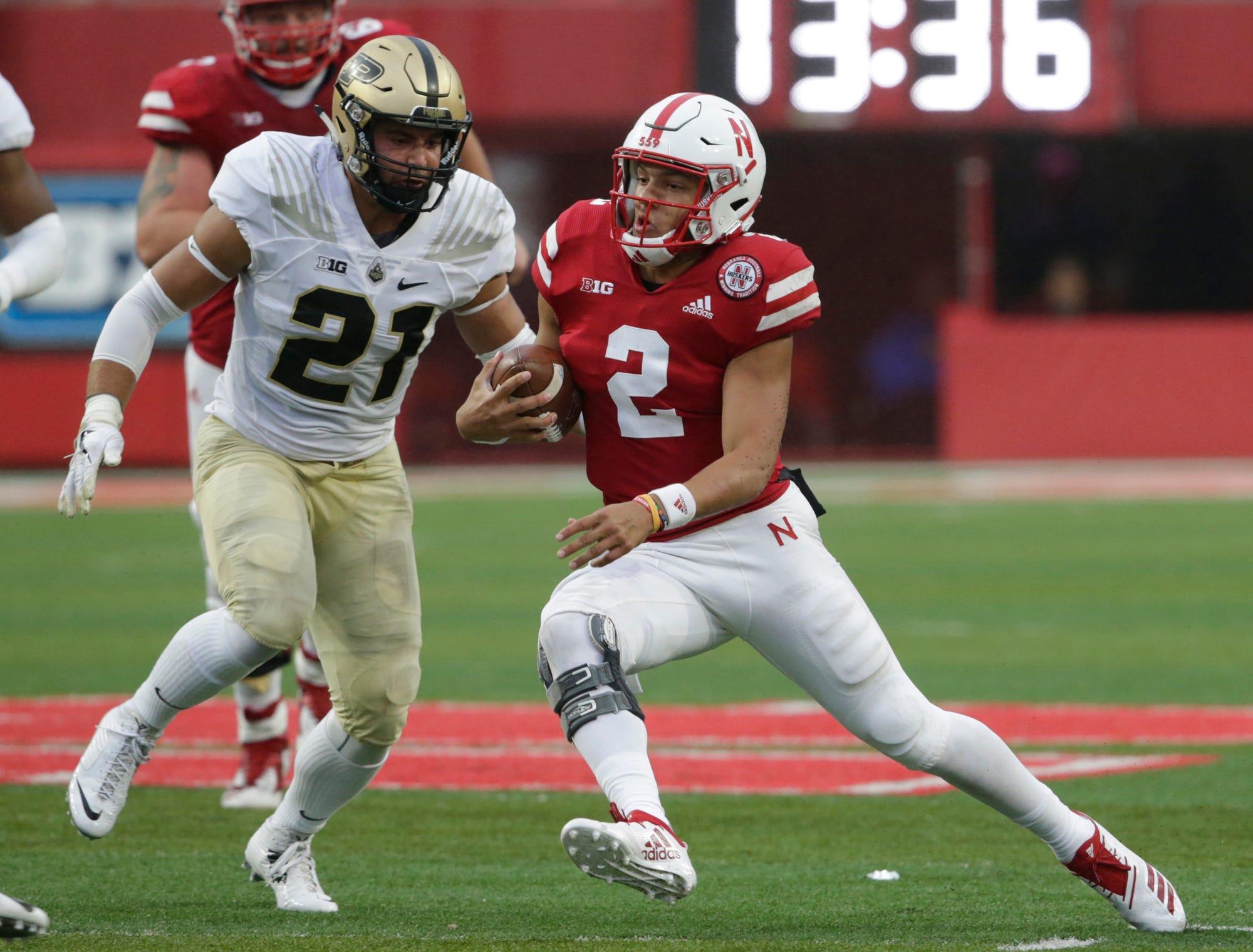 Nebraska quarterback Adrian Martinez (2) carries the ball against Purdue linebacker Markus Bailey (21) during the second half of an NCAA college football game in Lincoln, Neb., Saturday, Sept. 29, 2018. Purdue won 42-28. (AP Photo/Nati Harnik)