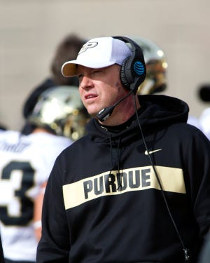Purdue coach Jeff Brohm observes his team before the start of last Saturday's victory at Illinois.