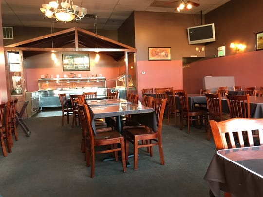 India Mahal offers a spacious dining room and its buffet, which in the background, is well stocked with Indian food to fit most people's palette.