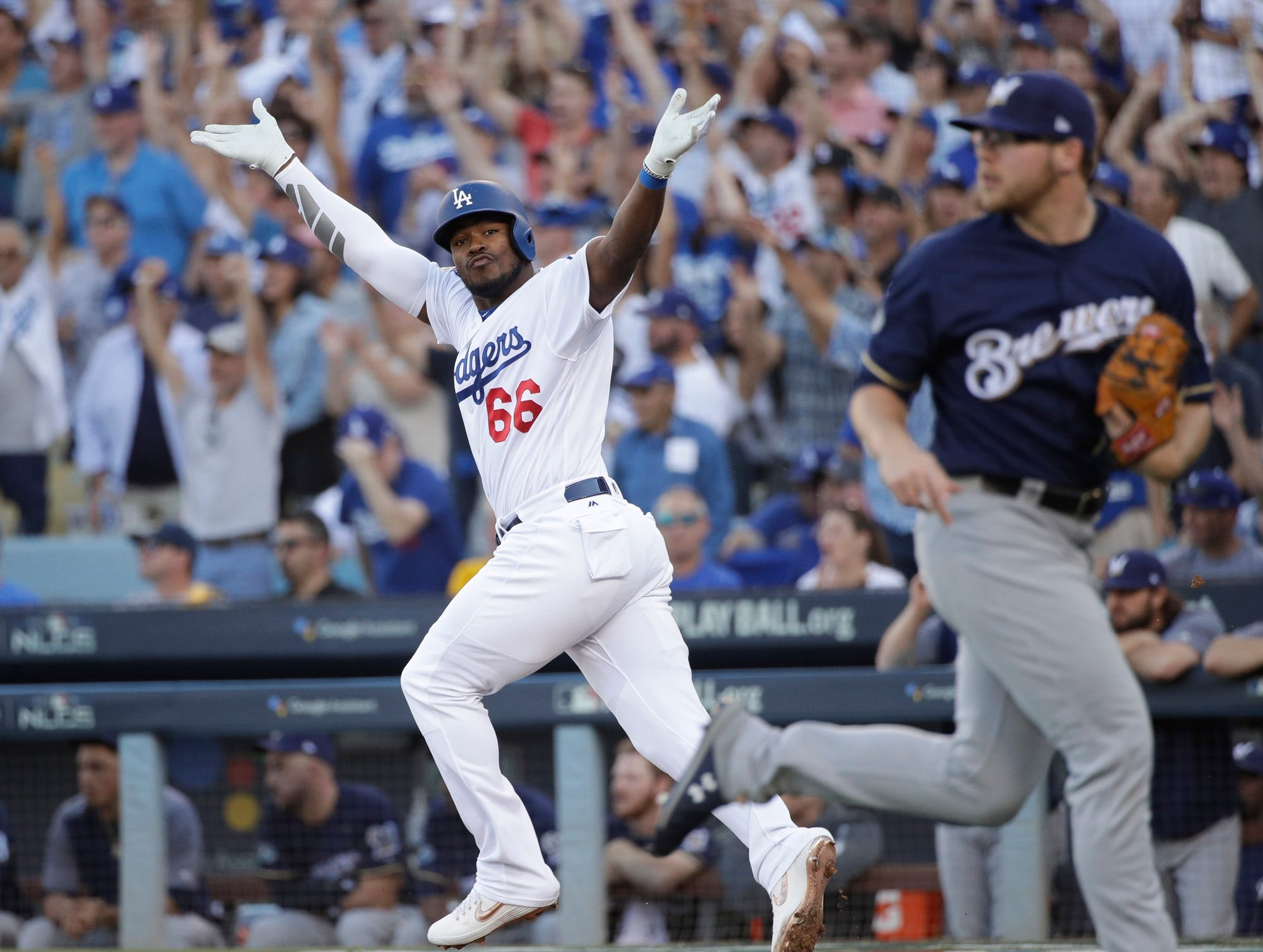 Los Angeles Dodgers' Yasiel Puig reacts after hitting an RBI single during the sixth inning of Game 5 of the National League Championship Series baseball game against the Milwaukee Brewers Wednesday, Oct. 17, 2018, in Los Angeles. (AP Photo/Jae Hong)