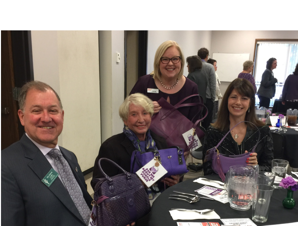 Ivy Tech Vice Chancellor Dr. John Laws. Pat Carr, Angie Klink and Allison Beggs all had their Purple Purses at the YWCA Network Luncheon. Angie Klink is currently the top fundraiser in this new initiative for the YWCA's Domestic Violence program.