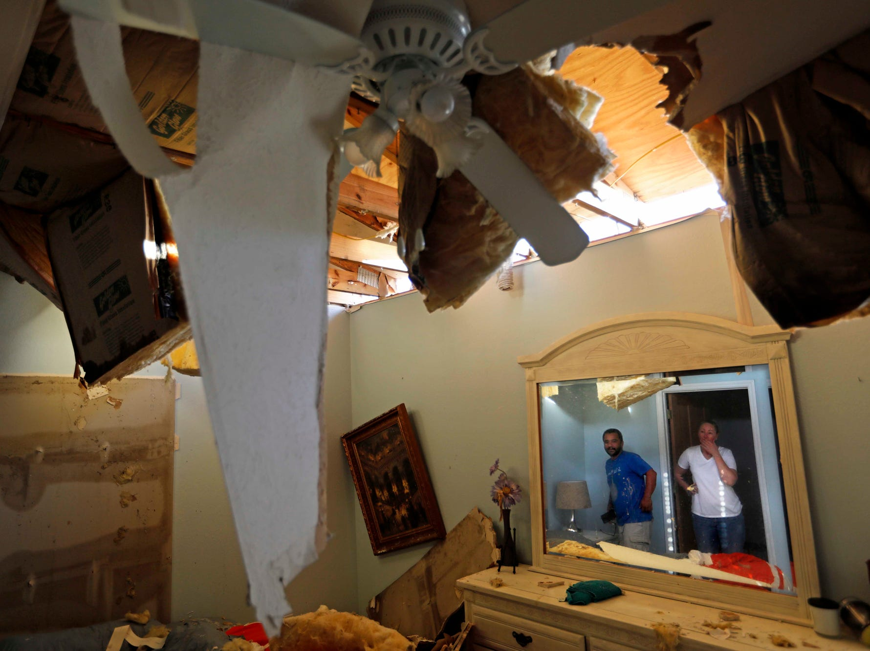 Samantha, right, and Rudy Martinez, survey the damage as they return home for the first time since Hurricane Michael hit Mexico Beach, Fla., Tuesday, Oct. 16, 2018. (AP Photo/David Goldman)