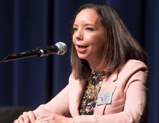 Mona Shand, Democratic candidate for Representative of the 42nd State District, explains her stance in the candidates forum held Thursday, Oct. 18, 2018.
