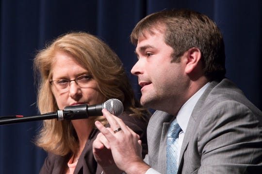 Lana Theis, Republican candidate for the 22nd State Senate, listens to Democratic candidate Adam Dreher at the candidates forum held Thursday, Oct. 18, 2018.