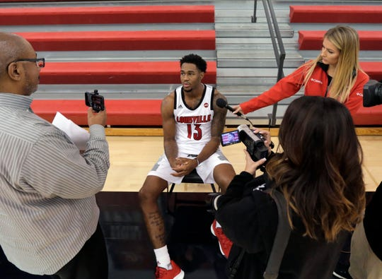 Louisville's V.J. King is interviewed at the team's media day on Friday.