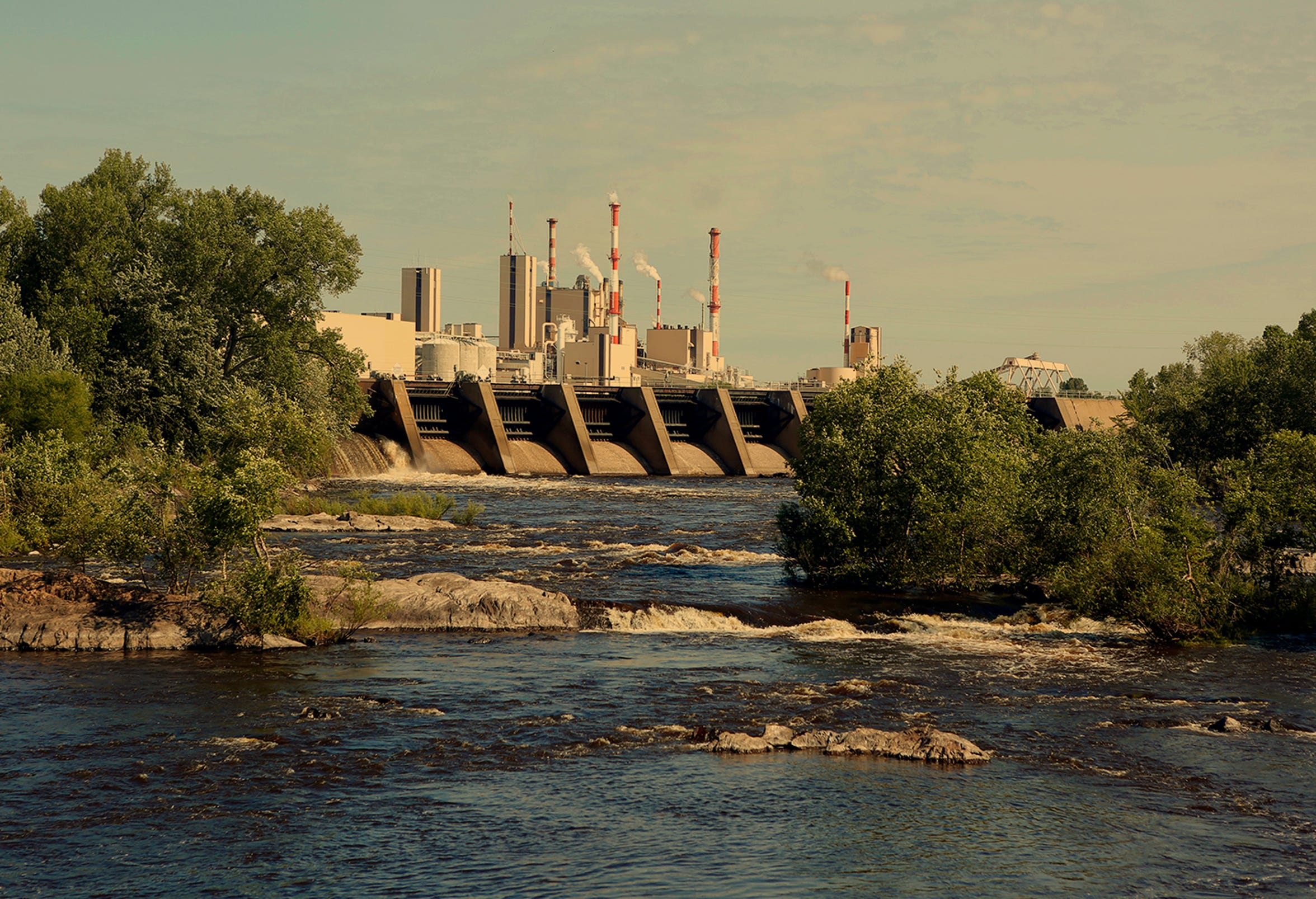 The Wisconsin River flows past a Verso Corporation paper mill which dominates the downtown area of Wisconsin Rapids. Cody Jackson was born and raised in the area.