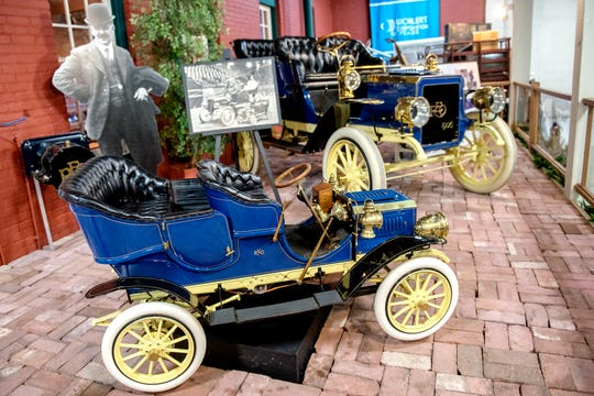 "A 1906 Olds and a miniature copy, known as the ""mama and baby"" Olds are on display at the R.E. Olds Transportation Museum on Monday, Oct. 8, 2018, in Lansing. The cars are owned by Debbbie Stephens, the great-granddaughter of R.E. Olds, and her husband, Peter."