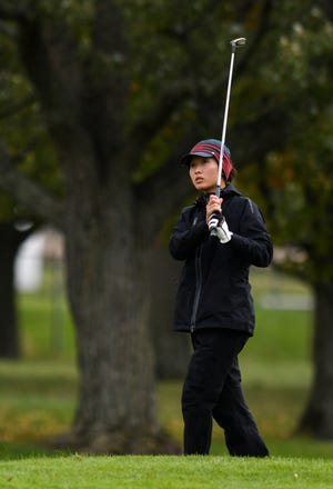 Allison Cui of Okemos watches the ball Friday, Oct. 19, 2018, during the Div. 2 girls golf finals at MSU's Forest Akers West in East Lansing.