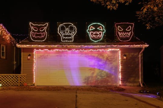 Custom-made heads lip sync songs in the Frosty's Festival of Lights Halloween display Oct. 17 in Manitowoc.