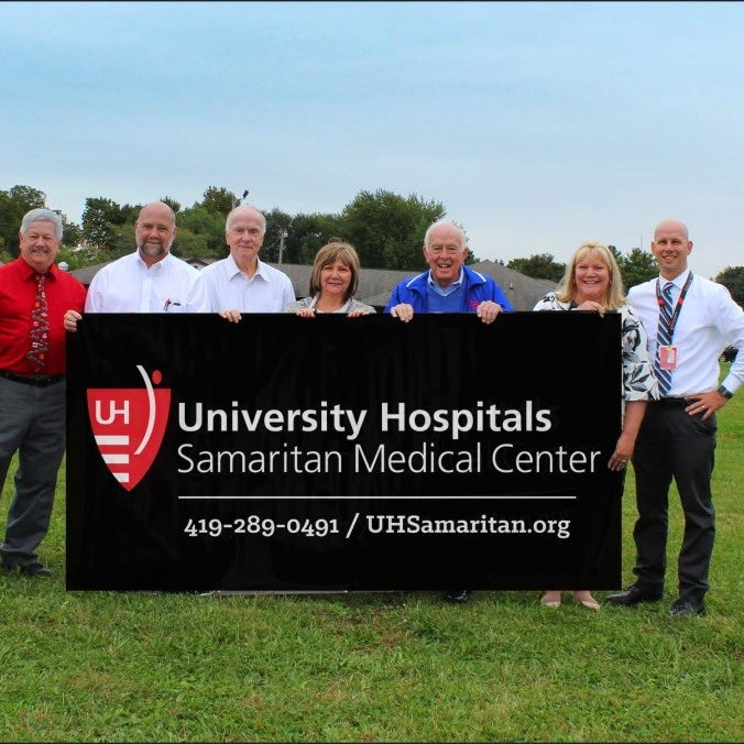 New London Mayor John Martin, Mark Chase, Richard Beal, Samaritan Hospital Foundation, and donor Bob Archer pose with UH Samaritan Medical Center's Karen McNeil, Lisa Bushong and Bryan Finger. The site will be home to a $1 million healthcare facility featuring an urgent care and space for future growth.