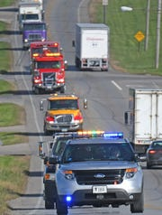 A convoy of emergency vehicles travel south on Ohio 13 to raise awareness of the Move Over law.
